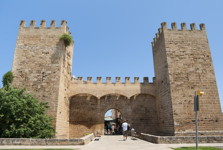 City wall gate in Alcudia, Mallorca, Spain photo