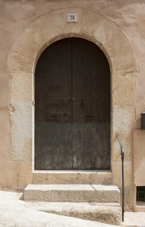 Old wooden door of house in mountain village Valldemossa, Mallorca, Spain Stock Photo - 23157200