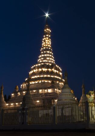 Buddha stupa on Wat Luang at Pai Maehongson North temple in Thailand photo