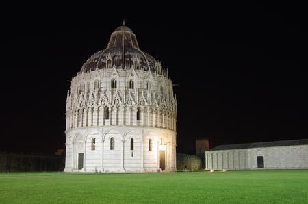 Baptistery of St. John on the Field of Miracles in the night, Pisa, Italy photo