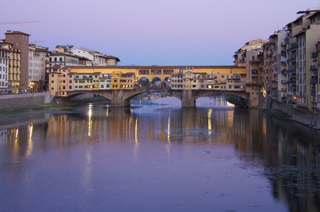 Ponte Vecchio bridge across Arno River in the evening, Florence, Italy photo