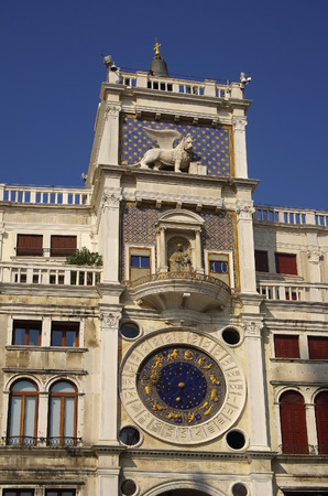 The Clock Tower with astronomical clock (15th century) at Saint Mark's square, Venice,  Italy photo