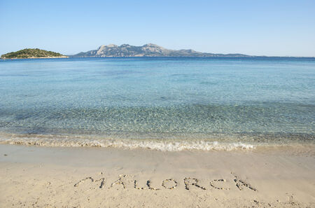 majorca: Inscription on the beach of Mediterranean sea, Mallorca, Spain