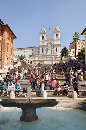 ROME - September 29:  Spanish Steps on September 29, 2011 in Rome, Italy. Tourists relax in the famous Spanish steps  between the Piazza di Spagna at the base and Piazza Trinita dei Monti