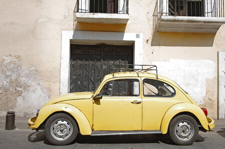 Yellow vintage VW Beetle on the street of Puebla, Mexico Editorial