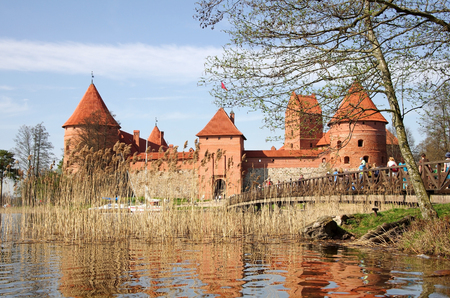 TRAKAI, LITHUANIA - APRIL 28  Castle in Trakai on April 28, 2012  Medieval castle in Trakai, the first capital city of Lithuania  Located on an island in the middle of a lake is one of the most popular tourist attraction in the country