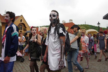 PRAGUE, CZECH REPUBLIC - MAY 05: Zombie Walk on Charles bridges on MAY 05, 2012 CZECH REPUBLIC. Unidentified people take part in Zombie Walk Parade in the center of Prague Editorial
