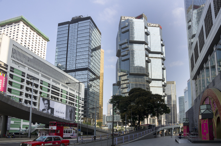 taller: HONG KONG - FEBRUARY 23: Central business district on February 23, 2013 in Hong Kong. Hong Kong is an international financial centre that has 112 buildings that stand taller than 180 metres Editorial