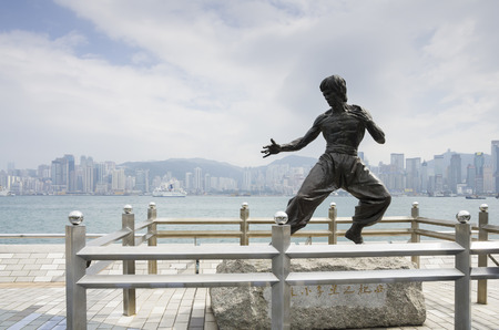 HONG KONG - FEBRUARY 25: The statue of Bruce Lee at Avenue of Stars on Kowloon Island on February 25, 2013 Hong Kong. The 2.5 meter bronze statue to commemorate the legendary Bruce Lee along the avenue of stars attraction