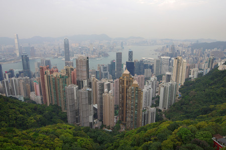 taller: HONG KONG - MARCH 04: View of modern skyscrapers from Victoria peak on March 04, 2013 in Hong Kong. Hong Kong is an international financial centre that has 112 buildings that stand taller than 180 metres