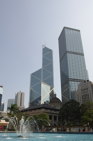 taller: HONG KONG - MARCH 05: View of modern skyscrapers on March 05, 2013 in Hong Kong. Hong Kong is an international financial centre that has 112 buildings that stand taller than 180 metres