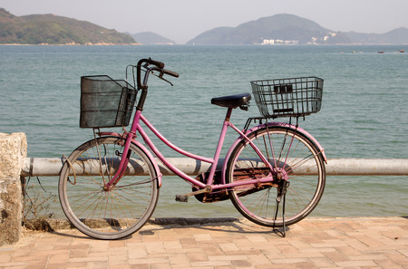 bycicle: Old bycicle on the quay of Lantau Island, Hong Kong