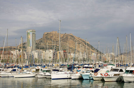 ALICANTE - NOVEMBER 26: Alicante harbor on NOVEMBER 26, 2012 SPAIN. View of harbour with yachts and Castle of Santa Barbara in background at Alicante