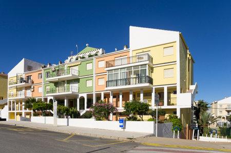 spanish houses: TORREVIEJA, SPAIN - NOVEMBER 27: Houses of resort Torrevieja on NOVEMBER 27, 2012 SPAIN. Colourful spanish houses at Torrevieja - resort at coast Costa Blanca, Spain