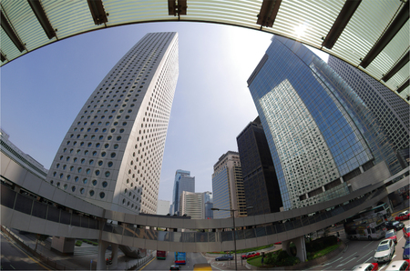 taller: HONG KONG - FEBRUARY 23: Fisheye view on skyscrapers on February 23, 2013 in Hong Kong. Hong Kong is an international financial centre that has 112 buildings that stand taller than 180 metres