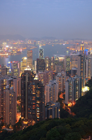 metres: HONG KONG - MARCH 04: View of modern skyscrapers from Victoria peak on March 04, 2013 in Hong Kong. Hong Kong is an international financial centre that has 112 buildings that stand taller than 180 metres