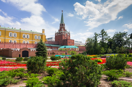 make public: MOSCOW - JULY 02: Moscow Kremlin on July 02, 2013, Moscow, Russia. Colourful flower beds of the first public park in Moscow (near the Moscow Kremlin) make it a favourite spot for the tourists