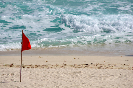 Red warning flag on the beach, Cancun, Mexico