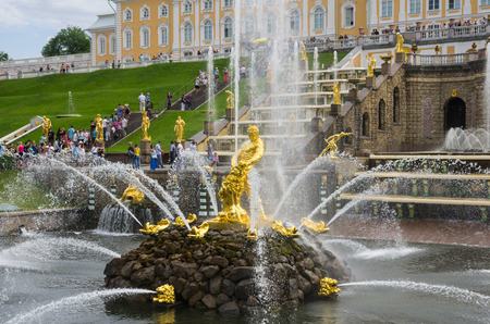 belongs: PETERHOF- JULY 07: Samson fountain of the Grand Cascade on July 07, 2013, Saint-Petersburg, Russia. The park ensemble of Peterhof belongs to the world heritage of UNESCO Editorial