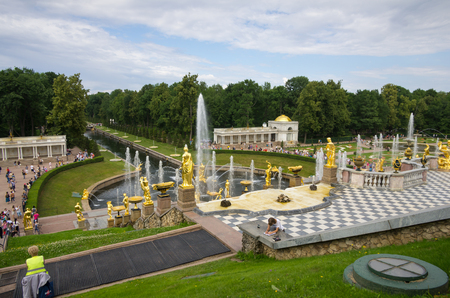PETERHOF- JULY 07: Fountains of the Grand Cascade on July 07, 2013, Saint-Petersburg, Russia. The park ensemble of Peterhof belongs to the world heritage of UNESCO