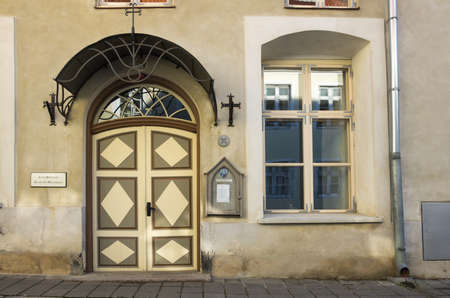 view of a wooden doorway: TALLINN - SEPTEMBER 12: Wooden door of old stone house on September 12, 2013, TALLINN, ESTONIA.