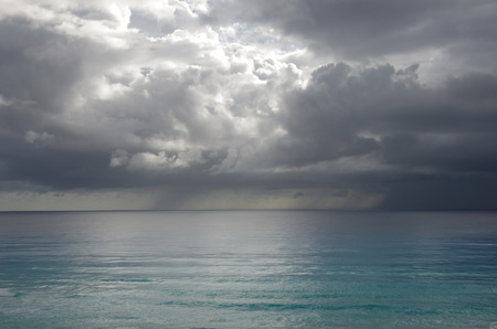 mexico beach: Stormy clouds over Caribbean sea, Cancun, Mexico