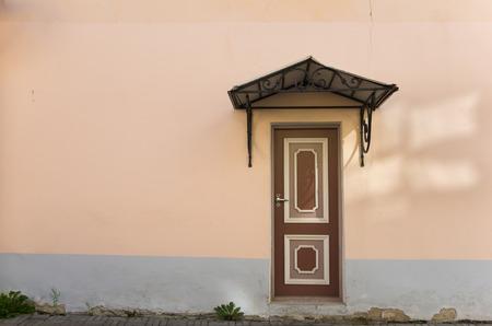 dilapidation: Colorful wooden door of old stone house, Tallinn, Estonia