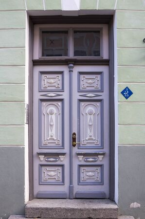 view of a wooden doorway: Wooden door of old stone house, Tallinn, Estonia