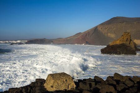 golfo: Lagoon and village El Golfo on Lanzarote, Canary islands, Spain Stock Photo