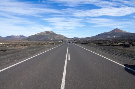 timanfaya: The road between typical vineyards in La Geria, Lanzarote, Canary Islands, Spain