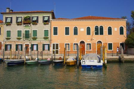Murano: VENICE, Italy - OCTOBER 06: Quay of Murano island on October 06, 2011 Venice, Italy. One of beautiful medieval venetian canals on Murano island in Venetian Lagoon