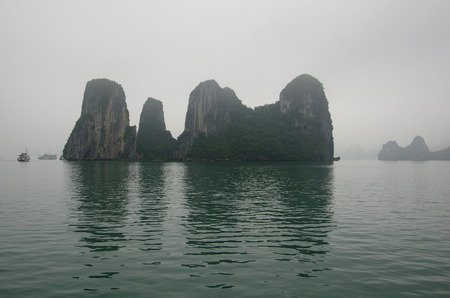 early fog: Early morning fog on limestone mountains, Halong bay, Vietnam Stock Photo