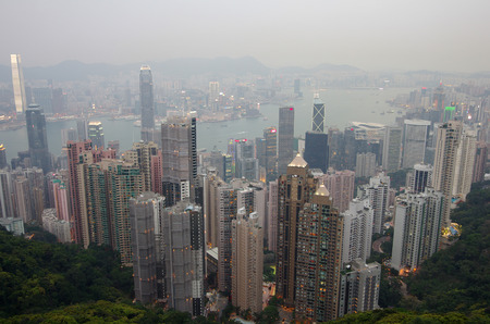taller: HONG KONG - MARCH 04: View of modern skyscrapers on March 04, 2013 in Hong Kong. Hong Kong is an international financial centre that has 112 buildings that stand taller than 180 metres