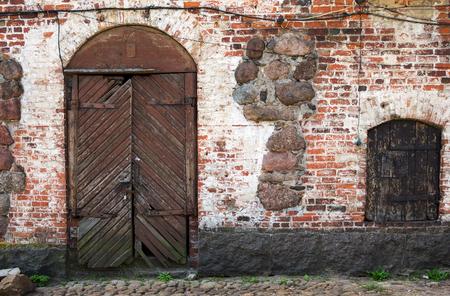 dilapidation: Old door at Swedish castle in Vyborg, Leningrad region, Russia
