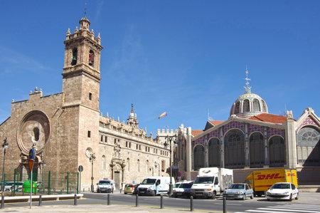 mercado central: VALENCIA, SPAIN - OCTOBER 07, 2014: Santos Juanes church and Mercado Central in Valencia, Spain. Historic Mercado Central is one of the oldest markets in Europe Editorial