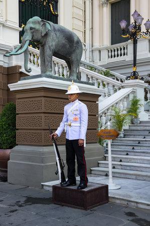 royal guard: BANGKOK, THAILAND - JANUARY 24, 2015: Wat Phra Kaew in Bangkok, Thailand. Unidentified Royal Guard is on duty at Thai Grand palace