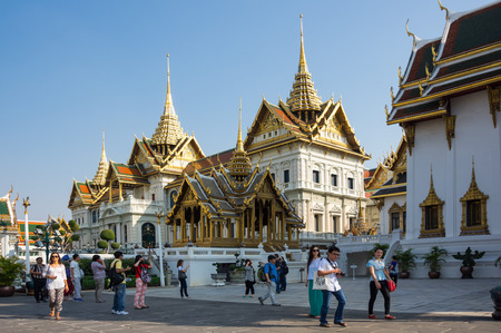 BANGKOK, THAILAND - JANUARY 24, 2015: Unidentified tourists visit the Grand Palace in Bangkok, Thailand. Grand Palace in Bangkok is the most famous landmark of Thailand