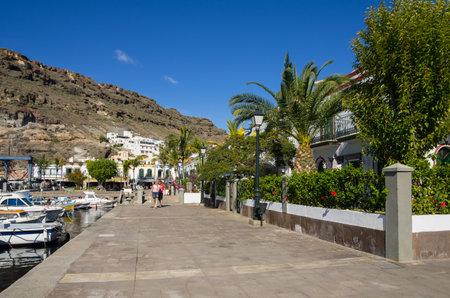 island: PUERTO DE MOGAN, GRAN CANARIA, CANARY ISLANDS - JANUARY 04, 2014: Quay with shops and restaurants in Puerto de Mogan, a small fishing port and resort on Gran Canaria Island, Spain Editorial