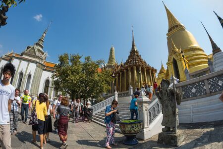 kaew: BANGKOK, THAILAND - JANUARY 24, 2015: Unidentified tourists at Wat Phra Kaew in Bangkok, Thailand. Wat Phra Kaew is one of the most popular tourists destination in Thailand.