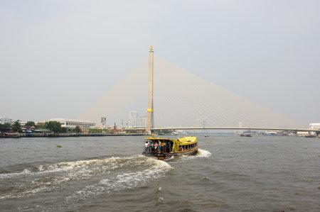 passenger ships: BANGKOK, THAILAND - JANUARY 25, 2015:  Passenger ships and houses along Chao Phraya River in Bangkok. Chao Phraya river is a major river in Thailand