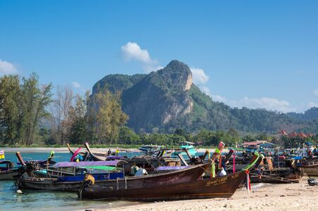 long tail: AO NANG BEACH, CRABI PROVINCE, THAILAND - FEBRUARY 02, 2015: Traditional thai long tail boats waiting for tourist to travel to beautiful islands in Thailand Editorial