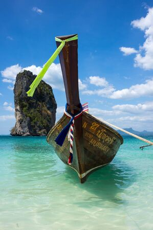 long tail: CRABI PROVINCE, THAILAND - FEBRUARY 02, 2015: Traditional thai long tail boats waiting for tourist to travel to beautiful islands in Thailand