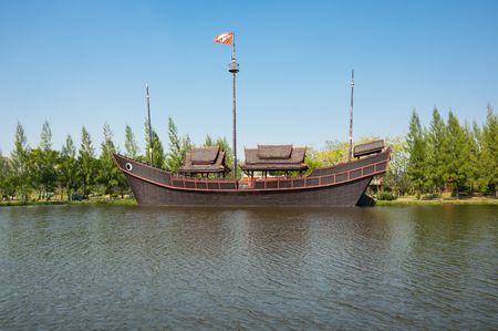 SAMUT PRAKAN, THAILAND - FEBRUARY 05, 2015: Boat in Ancient Siam (also known as Ancient City or Mueang Boran), the 320-hectare city with 116 structures of Thailands famous monuments