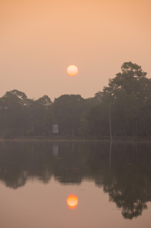 thom: Sunrise over lake at Angkor Thom in Siem Reap, Cambodia. Angkor Thom is a popular tourist attraction