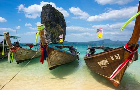 long tail: CRABI PROVINCE, THAILAND - FEBRUARY 02, 2015: Traditional thai long tail boats waiting for tourists to travel to beautiful islands in Thailand