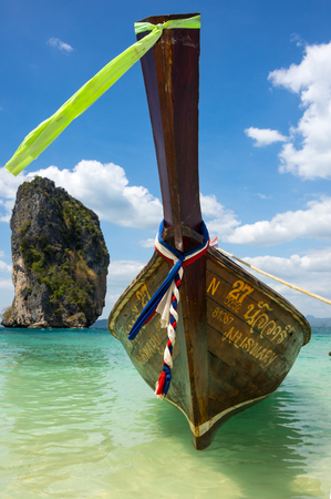 long tail: CRABI PROVINCE, THAILAND - FEBRUARY 02, 2015: Traditional thai long tail boat waiting for tourists to travel to beautiful islands in Thailand Editorial