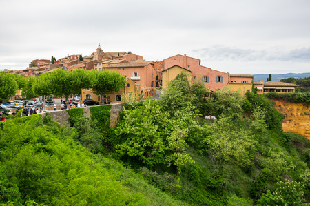 ochre: ROUSSILLON, FRANCE - MAY 03, 2015: View on the beautiful medieval village of Roussillon. It ochre village is included in list of The most beautiful villages of France