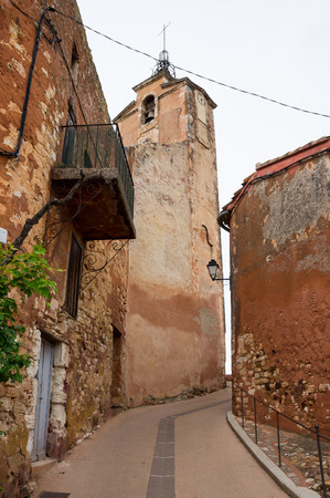 luberon: Street of medieval village of Roussillon. It ochre village is included in list of The most beautiful villages of France