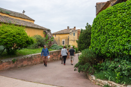 yellow ochre: ROUSSILLON, FRANCE - MAY 03, 2015: Street of medieval village of Roussillon. It ochre village is included in list of The most beautiful villages of France