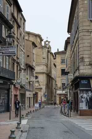 AVIGNON, FRANCE - MAY 04, 2015: Street scene in historical centre of Avignon. Avignon is a famous and very popular among tourists city in Provence in south of France